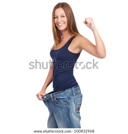 Young woman delighted with her dieting results, isolated on white	 - stock photo