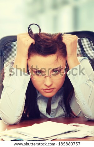 Young woman depressed because of bills - bankruptcy concept
