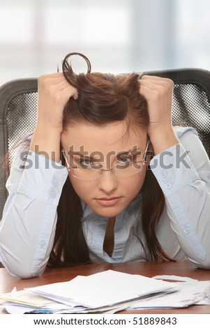 Young woman depressed because of bills - bankruptcy concept - stock photo
