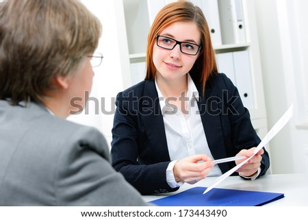 Young woman discussing during a job interview at office - stock photo