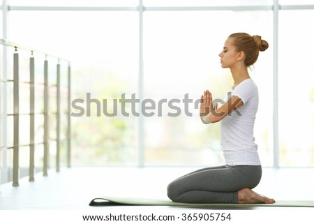 Young woman do yoga exercises - stock photo