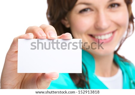 Young woman doctor is showing her business card, isolated over white