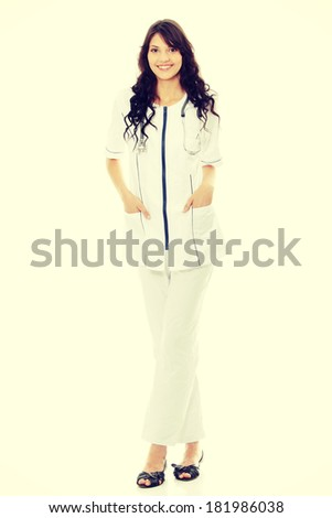 Young woman doctor or nurse - stock photo