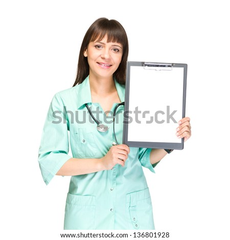 Young woman doctor or nurse showing empty blank clipboard sign with copy space for text.