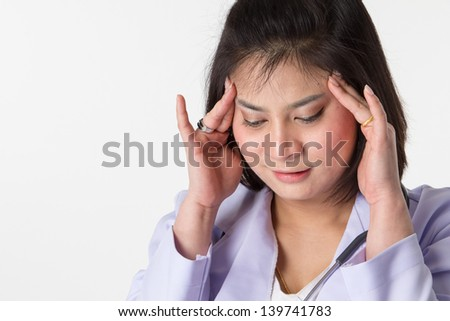 Young woman doctor or nurse stressed out and upset at work isolated on white background