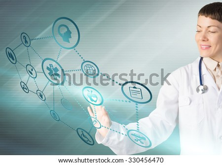 Young woman doctor touching icon of media screen
