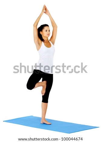 Young woman does yoga on mat. This is part of a series of various yoga poses by this model, isolated on white - stock photo