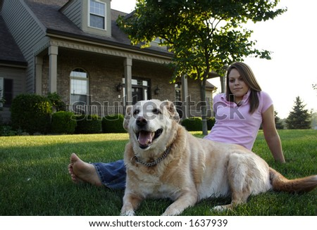 Young Woman & Dog - focus on dog - stock photo