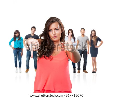 young woman doing a contradictory gesture - stock photo