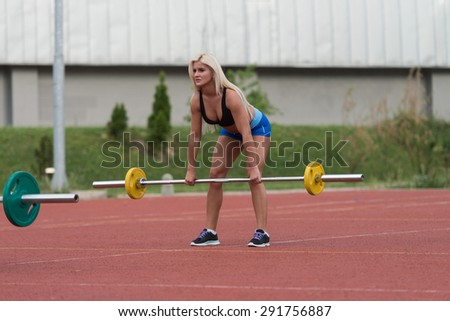 Young Woman Doing A Dead Lift Exercise Outdoor