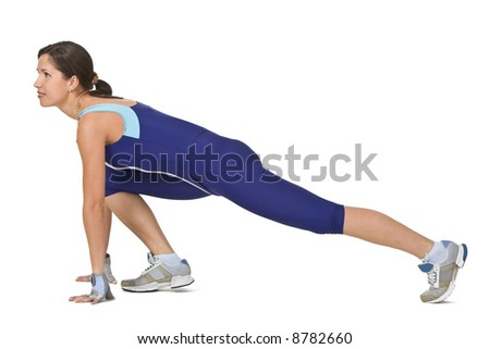 Young woman doing a lunge during a fitness exercise.