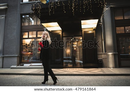 young woman doing a photo shoot on a street