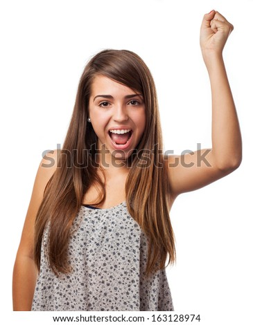 young woman doing a victory gesture isolated on white - stock photo