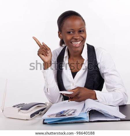 Young woman doing budget and coming up with a plan to her money problems. - stock photo