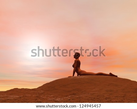 Young woman doing cobra pose, bhujangasana, while practicing yoga outside in front of sunset