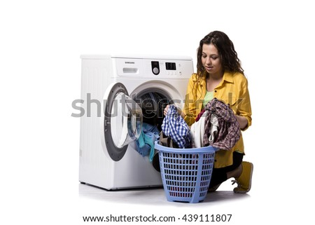 Young woman doing dirty laundry isolated on white