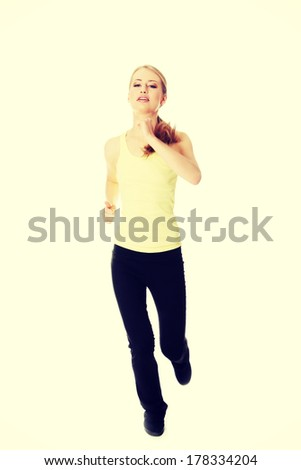 Young woman doing exercise , isolated on white - stock photo