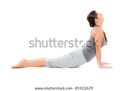 young woman doing exercise on floor. isolated on white background - stock photo
