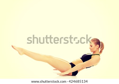 Young woman doing exercise on the floor - stock photo