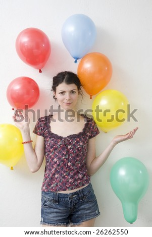 young woman doing exercise with balloon in gym
