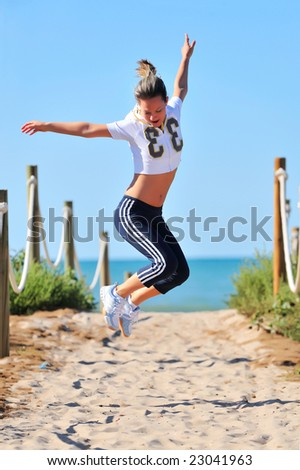 young woman doing exercises on the beach