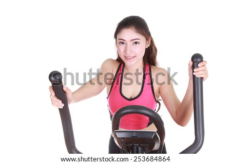 young woman doing exercises with exercise machine, on white background