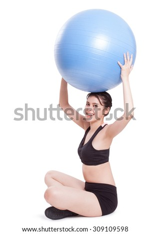 Young woman doing exercises with fitness ball
