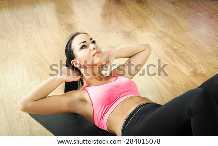 Young woman doing fitness exercises with fit ball - stock photo