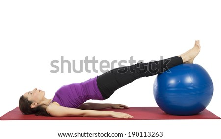 Young woman doing fitness with pilates ball.