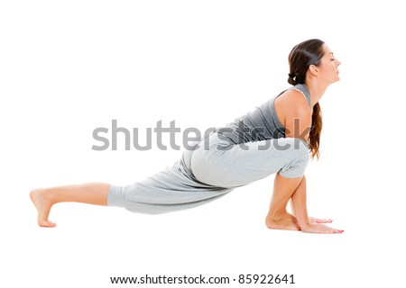 young woman doing flexibility exercise on floor. isolated on white background - stock photo