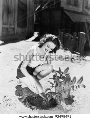 Young woman doing garden work - stock photo
