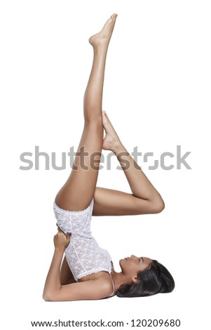 young woman doing gym with long beautiful legs. Isolated on white background. - stock photo