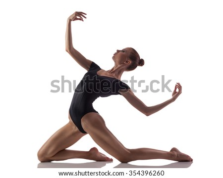 Young woman doing gymnastics exercise  over white isolated background - stock photo