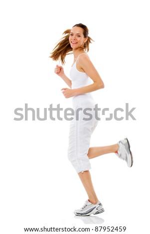 Young woman doing gymnastics on white background studio - stock photo