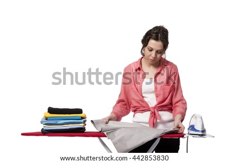 Young woman doing ironing isolated on white - stock photo