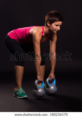 young woman doing kettlebell exercices - stock photo