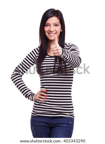 Young woman doing ok gesture with thumb up - stock photo
