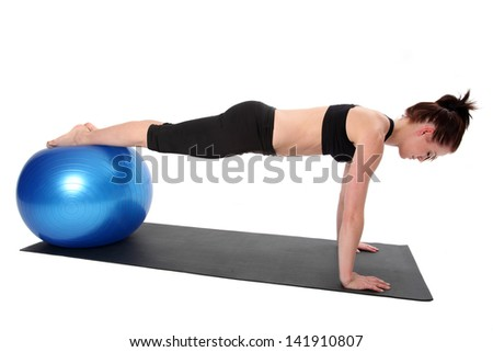 Young woman doing Pilates.  Isolated on a white background.
