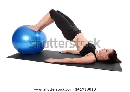 Young woman doing Pilates.  Isolated on a white background. - stock photo
