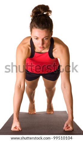 young woman doing press ups. - stock photo