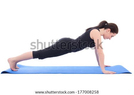 young woman doing push up exercise isolated on white background - stock photo