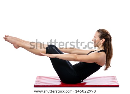 Young woman doing resistance exercise on Pilates training