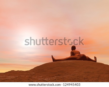 Young woman doing seated angle pose, upavista konasana, while practicing yoga outside in front of sunset