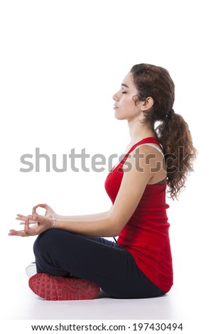Young woman doing some yoga after the exercise (isolated on white) - stock photo