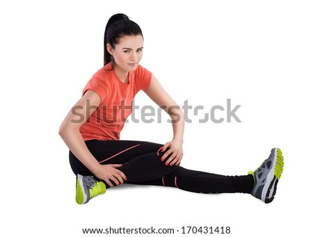 Young woman doing stretching exercise. - stock photo