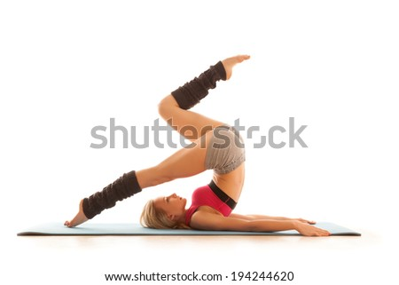 Young woman doing stretching exercise at home. Gymnastics series isolated on white. - stock photo