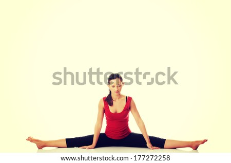 Young woman doing stretching exercise, isolated on white