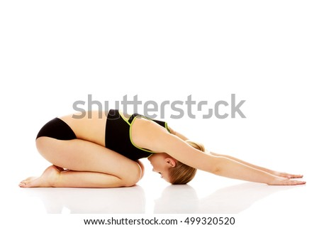 Young woman doing stretching exercise on the floor