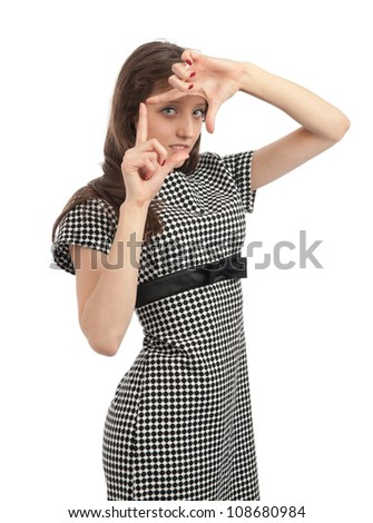 Young woman doing viewfinder gesture - stock photo