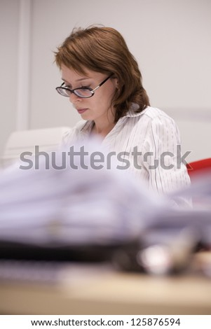 Young woman doing work in the office